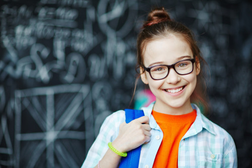 Girl Starting School with Bright Smile